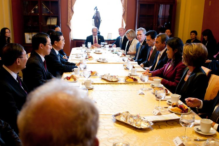 House Speaker John Boehner (R-Ohio) sits across from Chinese Communist Party Chairman Hu Jintao at the U.S. Congress on Jan. 20. Around the table are a bipartisan group of lawmakers and members of Hu's entourage. (Courtesy of Speaker John Boehner's office)