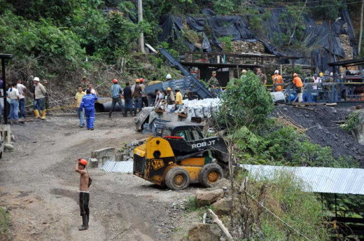 Miners stand by the mine entrance after 'La Preciosa' coal mine exploded in Corregimiento San Roque, Sardinata's municipality, department of Norte de Santander, Colombia on January 26, 2011. (Guillermo Legaria/AFP/Getty Images)