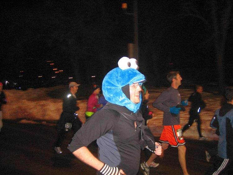 A man wearing a Cookie Monster costume runs in the annual Emerald Nuts Midnight Run in Central Park on New Year's Eve.  (Christian Watjen/The Epoch Times)