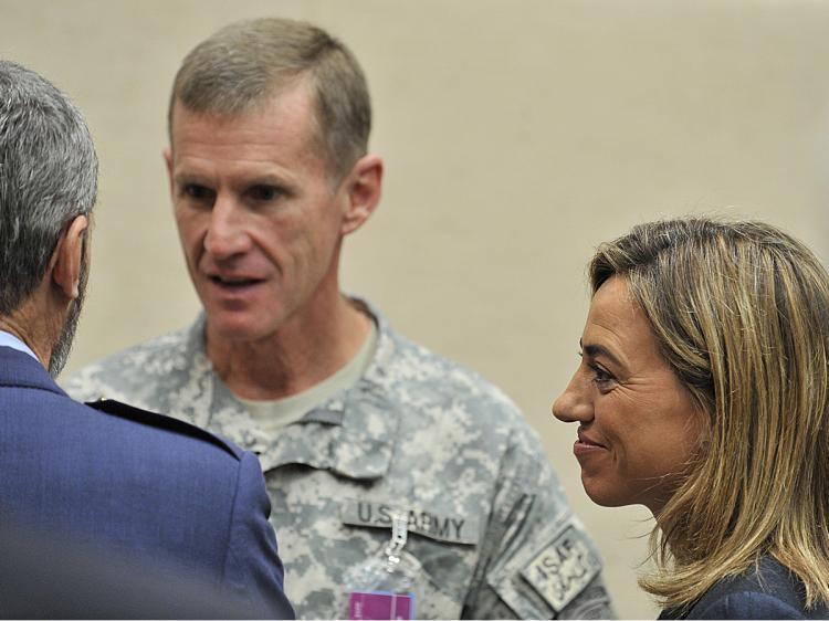 The top US commander in Afghanistan, General Stanley McChrystal (C), speaks with Spanish Defense Minister Carme Chacon (L) on June 11, 2010 before the start of the NATO defense ministers meeting in Brussels. (Georges Gobet/AFP/Getty Images)