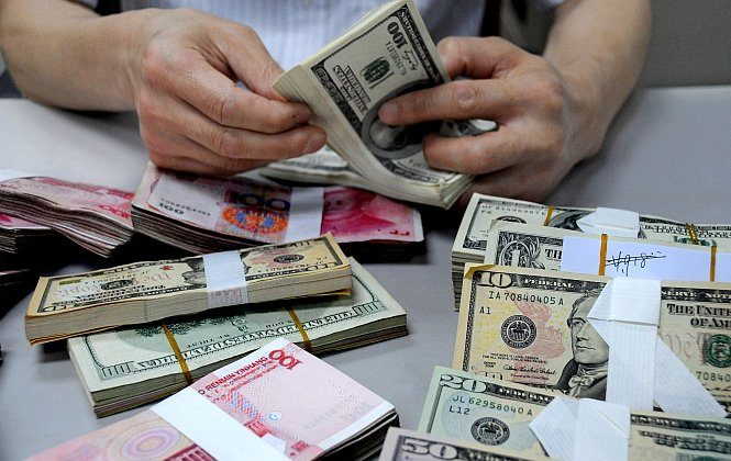 A staff member counts money at a branch of the Bank of China in Lianyungang, Jiangsu Province, China, in this file photo. (ChinaFotoPress/Getty Images)