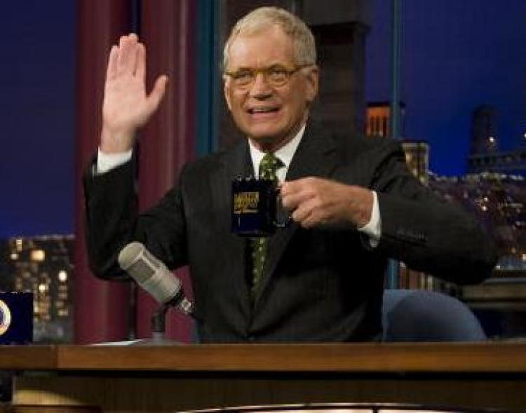David Letterman gestures during a taping of the 'Late Show with David Letterman' in New York. (Jim Watson/AFP/Getty Images)