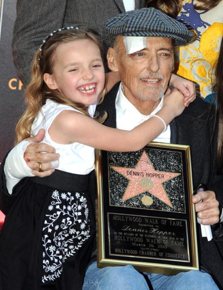 Dennis Hopper poses with his daughter Galen after being honored with a star on the Hollywood Walk of Fame in Hollywood in March of this year. Hopper succumbed to cancer today. He starred in such cinematic classics as 'Easy Rider' and 'Apocalypse Now.' (Gabriel Bouys/AFP/Getty Images)