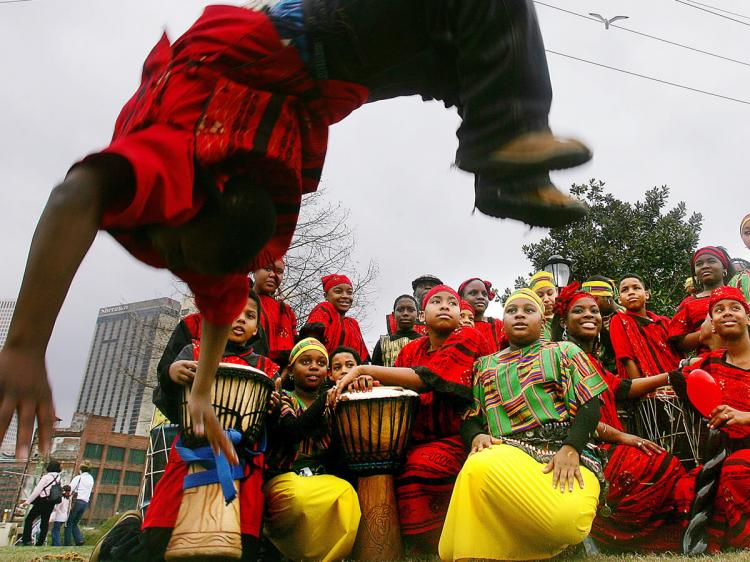 A GOOD TIME: The Djembe drum is a part of everyday life of African people. B.W. Cooper Dance and Drum Troupe, an African-inspired group at Mardi Gras festivities in New Orleans, Louisiana. (Mario Tama/Getty Images)
