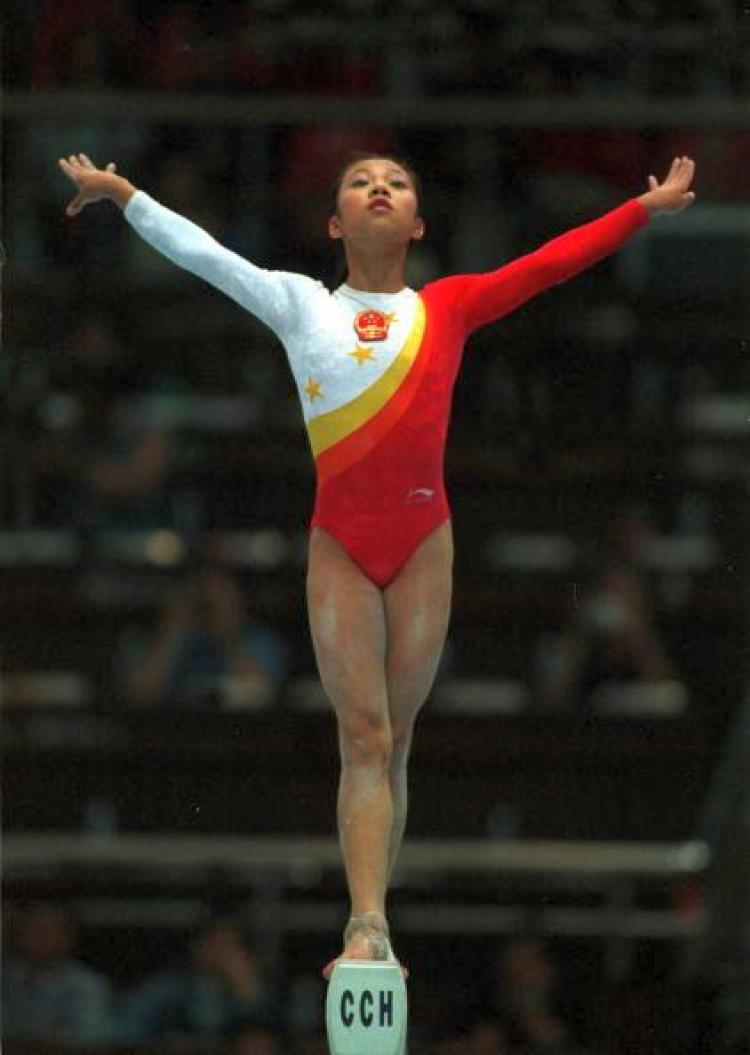 Fangxiao Dong of China performs her balance beam routine during the womens teams final at the 1999 Tianjin World Gymnastics Championships, Tianjin, China. China finished third. (Jack Atley/ALLSPORT)