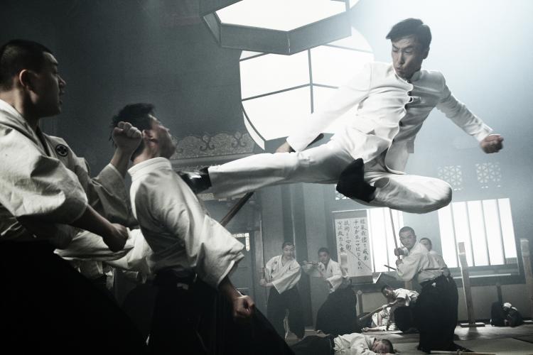 DROPKICK: Donnie Yen jump kicks a Japanese martial artist in 'Legend of the Fist: The Return of Chen Zhen.'