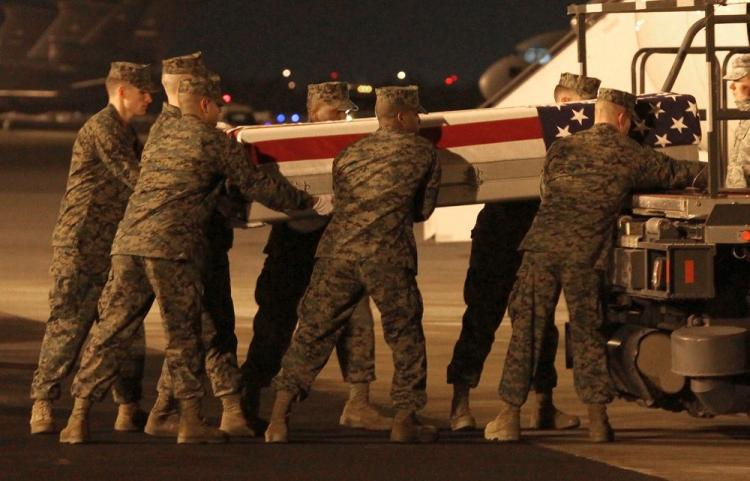 A U.S. Marine carry team moves the transfer case of Marine Pfc. Jason H. Estopinal during a dignified transfer at Dover Air Force Base in this file photo from Feb. 17, 2010, in Dover, Delaware.  (Mark Wilson/Getty Images)