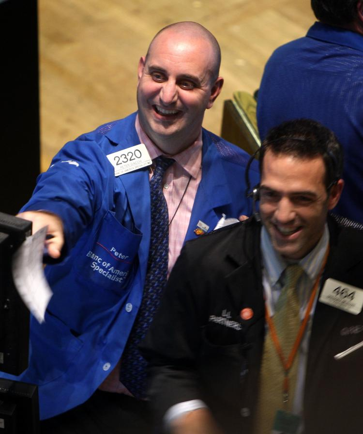 Traders on the floor of the New York Stock Exchange (NYSE) just before closing react to the high finishing number on the exchange October 28, 2008 in New York City. After a rally the Dow finished up nearly 900 points, gaining 10 percent. (Spencer Platt/Getty Images)