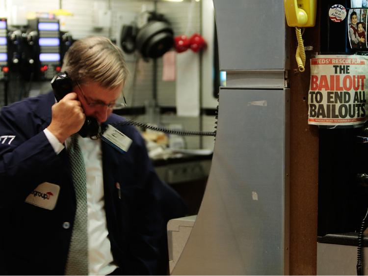 A financial professional uses a telephone on the floor of the New York Stock Exchange near the end of the day's trading January 7, 2009 in New York City.    (Chris Hondros/Getty Images)