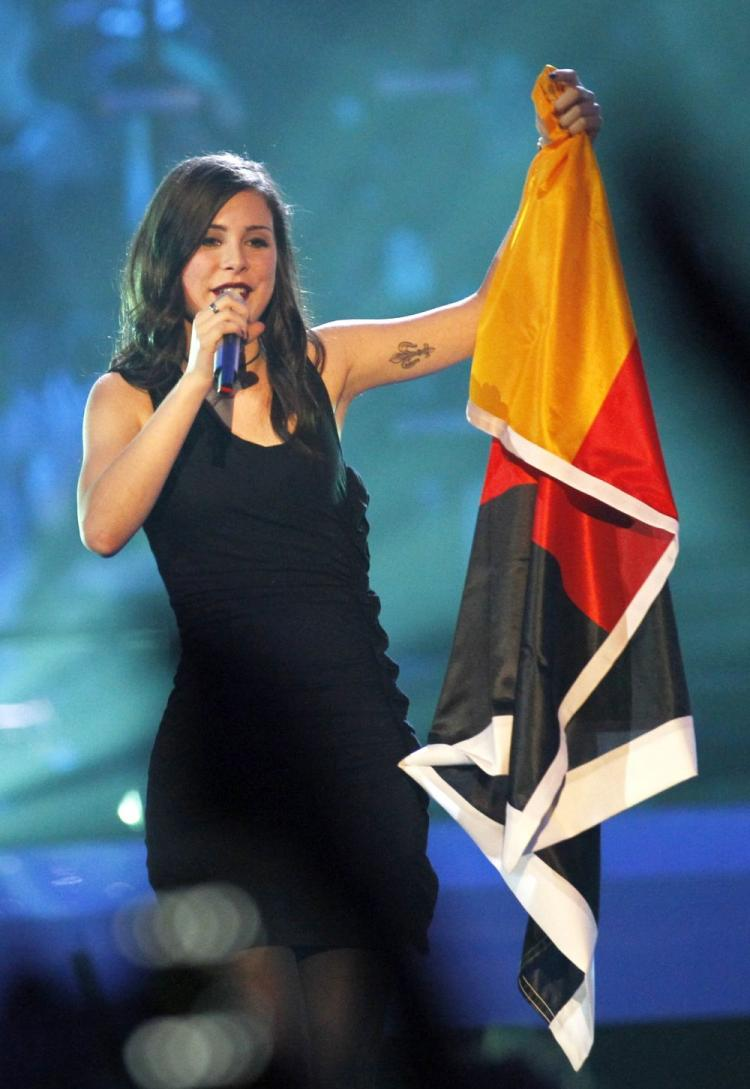 Germany's Lena Meyer-Landrut sings with her national flag after winning the Eurovision Song Contest 2010 final at the Telenor Arena in Baerum, near Oslo, Norway, on May 29. The 55th annual competition was expected to be watched by more than 120 million viewers in 39 European countries. (Daniel Sannum Lauten/AFP/Getty Images)
