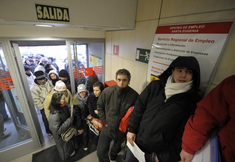 People queue as they wait for a government job center to open in Madrid on Jan. 22. The number of unemployed workers in Spain soared to a 12-year high point of more than 3 million in 2008 as the economy reeled from the collapse of the property market and  (Philippe Desmazes/AFP)