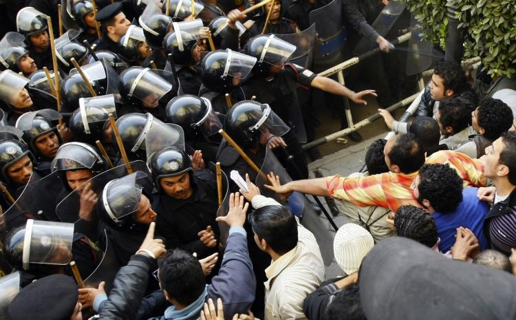 Egyptian demonstrators demanding the ouster of President Hosni Mubarak and calling for reforms face riot police in Cairo on January 26, 2011. (Mohammed Abed/AFP/Getty Images)