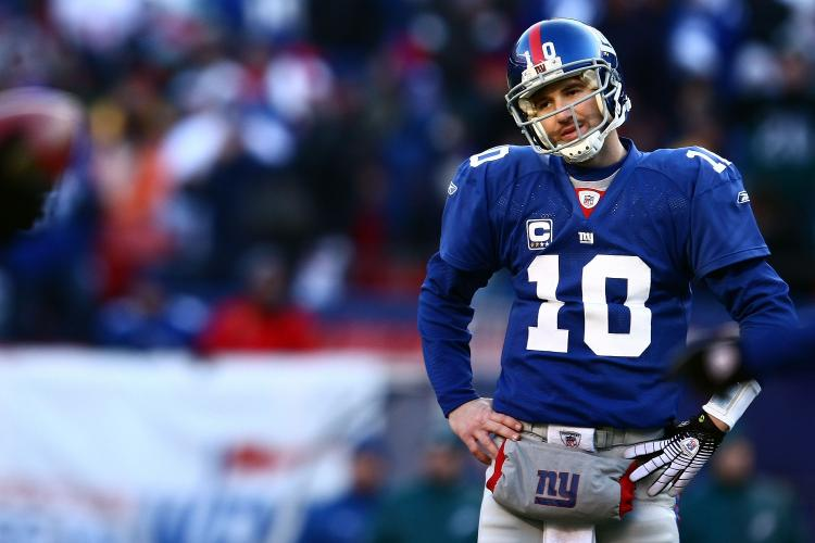 DISAPPOINTMENT: Eli Manning had a rough day, throwing two interceptions, one of which was returned to the Giants goal line setting up an Eagles score.  (Chris McGrath/Getty Images)