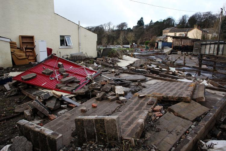Debris litters the garden of a home in the wake of last weeks devastating floods in Cumbria on November 25, 2009 in Cockermouth, England.  (Christopher Furlong/Getty Images)