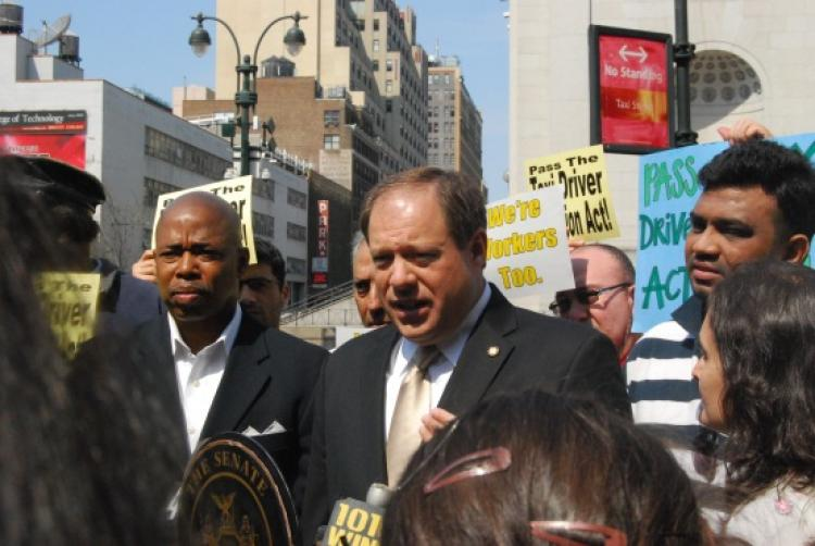 New York state Sen. Eric Adams (L) and taxi driver Mohammed Chowdury at a press conference on Sunday to increase the penalty for attacking taxi drivers to a felony. Chowdury was violently attacked by two passengers who cut his throat with a knife. (Catherine Yang/The Epoch Times)