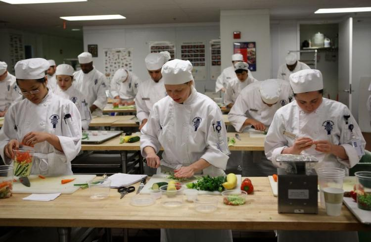 Culinary students do prep work for a meal during a butchery class at the Le Cordon Bleu program at California Culinary Academy April 8, 2009 in San Francisco, California.  (Justin Sullivan/Getty Images)