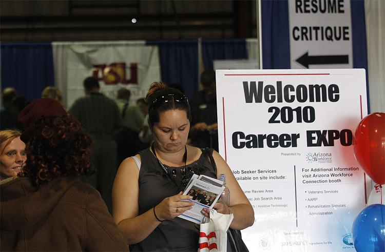 A woman attends the Arizona Workforce Connection Career Expo at the Arizona State Fair Grounds on March 31, 2010 in Phoenix, Arizona. (Joshua Lott/Getty Images)