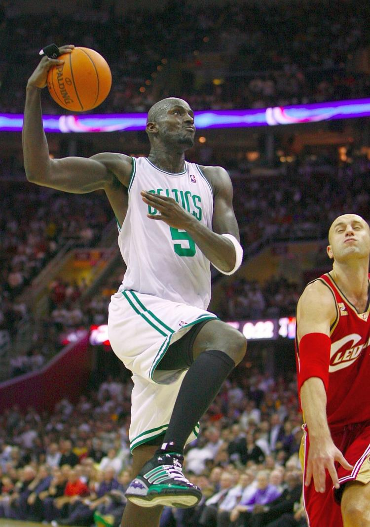 Boston Celtics forward Kevin Garnett soared back to play in the season opener against the Cleveland Cavaliers after being out with a knee injury in last season's playoffs. The Celtics beat the Cavs 95-89. (Gregory Shamus/Getty Images)