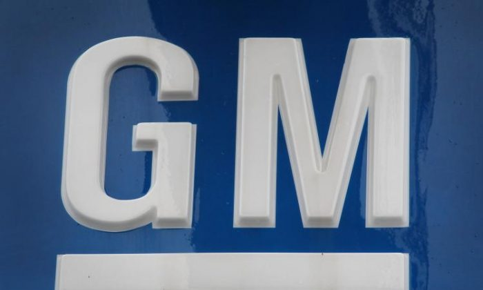 A General Motors Co. logo hangs above a Chevrolet dealership this past April in Chicago, Illinois. GM said on Tuesday that its July auto sales were up 5 percent from June.  (Scott Olson/Getty Images)