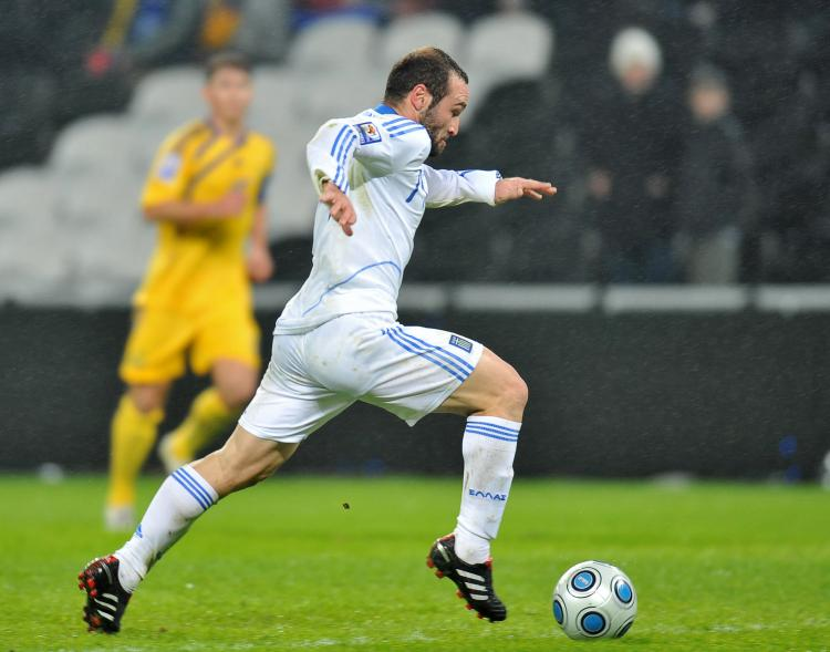 ON THE WAY TO GOAL: Greece's Dimitrios Salpigidis runs to score against Ukraine during their FIFA World Cup 2010 playoff qualification match in Donetsk on Wednesday. (SERGEI SUPINSKY/AFP/Getty Images)