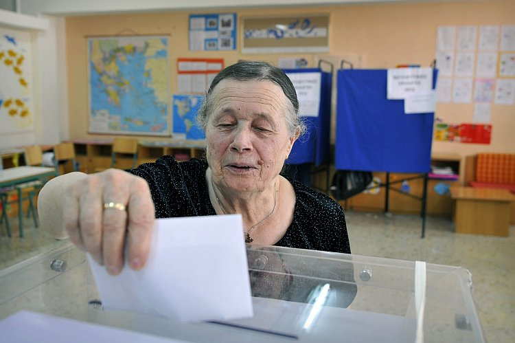 A woman casts her vote for  Greece's general elections
