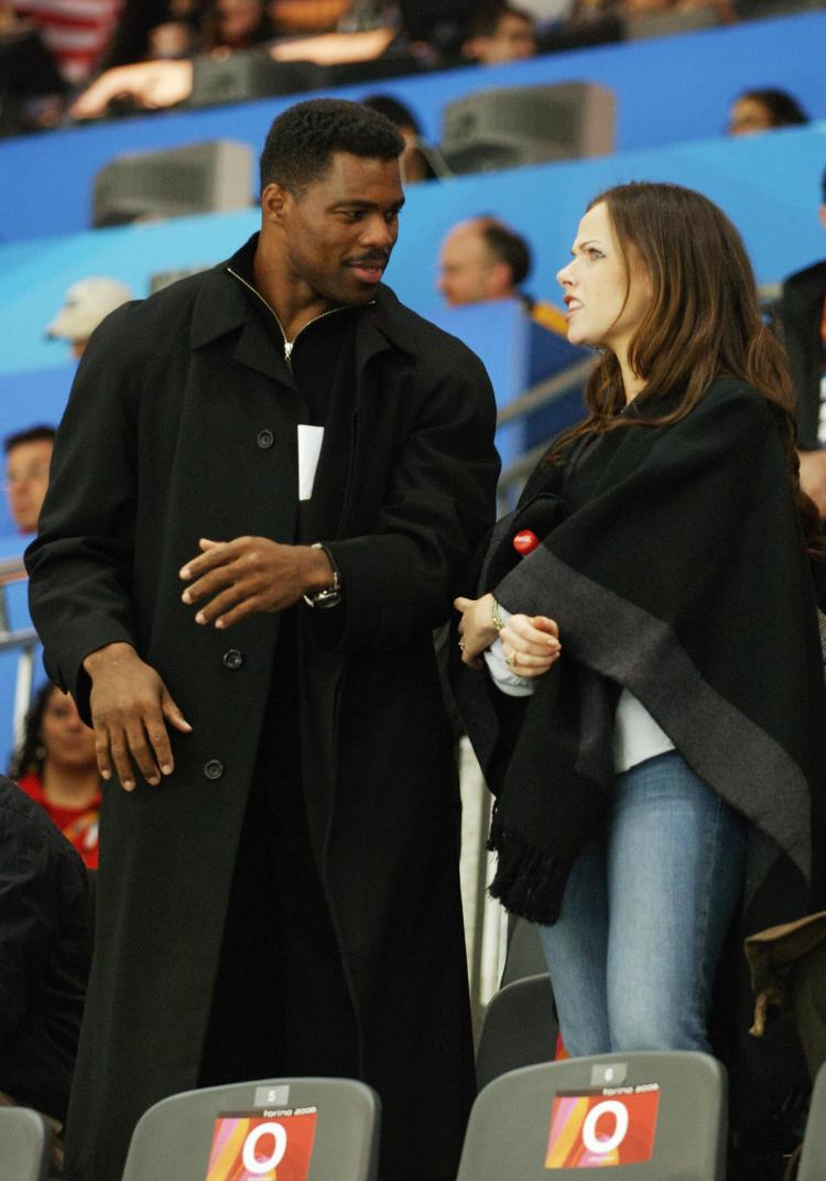 Herschel Walker (L) and Barbara Bush (R) at the USA vs Switzerland Women's Ice Hockey game of the 2006 Winter Olympics on Feb. 11 in Turin, Italy. Walker recently said he could make an NFL comeback at age 50. (MANDEL NGAN/AFP/Getty Images)