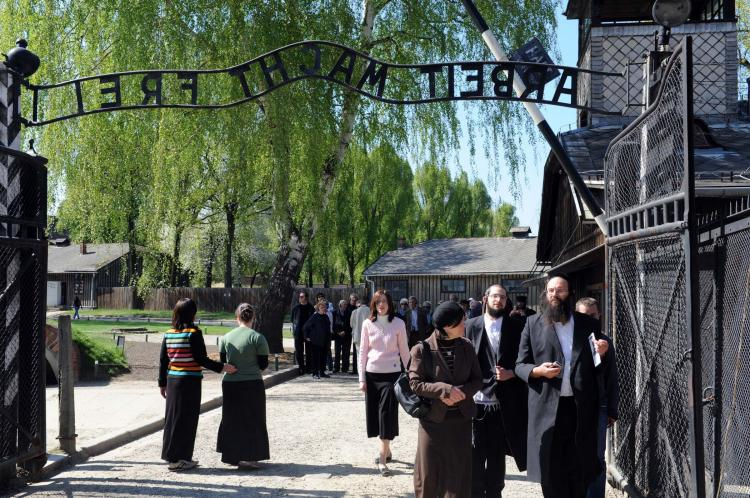 Jewish people gather at Auschwitz-Birkenau on the eve of Yom Hashoa Day on April 20, 2009 in Krakow, Poland. (Moshe Milner/GPO via Getty Images)