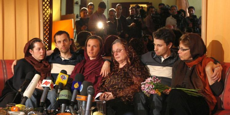 Detained US hikers Shane Bauer (2nd-L), Sarah Shourd (C-L) and Josh Fattal (2nd-R) sit with their mothers during their first meeting since their arrest, in the Iranian capital Tehran on May 20. Iran says the Americans are spies and has suggested that U.S. decide whether it wants a prisoner exchange. (Atta Kenare/AFP/Getty Images)