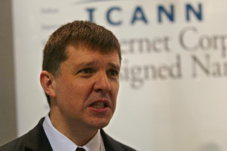 In this file photo, Internet Corporation for Assigned Names and Numbers (Icann) CEO Paul Twomey answers a visitor's question at the Icann stand of the World Summit on the Internet Society (WSIS). Icann has approved non-Latin languages for use in domain na (Abdelhak Senna/AFP/Getty Images)