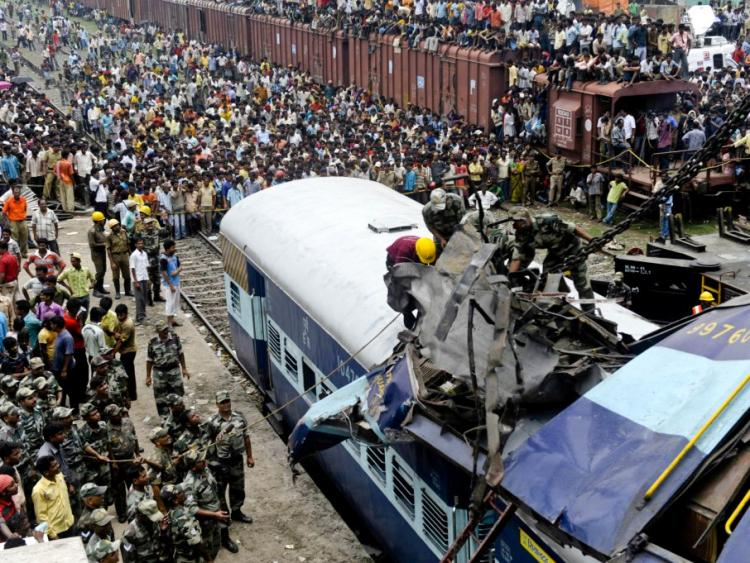 FATAL COLLISION: Rescue personnel in India conduct recovery operations on the mangled wreckage of a train following a railway accident in Sainthia, some 162 miles north of Kolkata, on July 19. (Deshakalyan Chowdhury/AFP/Getty Images)