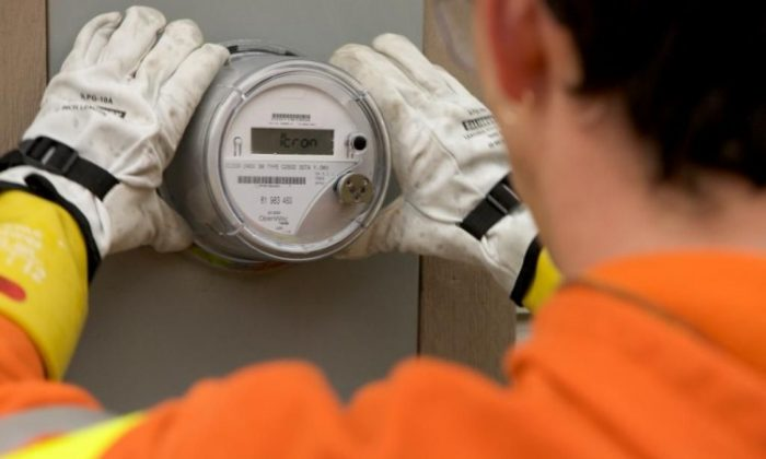 A worker with Corix Utilities installs a smart meter on a B.C. home. A survey commissioned by BC Hydro finds 20 percent of homeowners believe they are prepared for an extended power outage.  (BC Hydro)