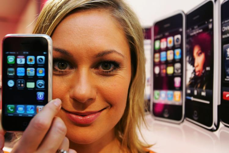 German actress Ruth Moschner presents the Apple iPhone on November 9, 2007 in Cologne, Germany. Walmart announced on Tuesday that it will be selling the Apple iPhone 3GS for $97, over $100 less than its current price tag.  (Patrik Stollarz/Getty Images)