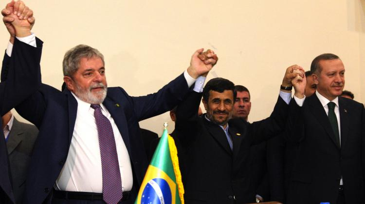 L to R: Brazilian President Luiz Inacio Lula da Silva, Iran's President Mahmoud Ahmadinejad and Turkish Prime Minister Recep Tayyip Erdogan pose with their hands together after the Islamic republic inked a nuclear fuel swap deal in Tehran on May 17. (Atta Kenare/Getty Images)