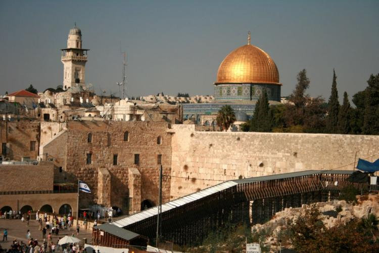 The Western Wall, Dome of the Rock, and Al-Aqsa Mosque intersect, layered above older versions of the city of Jerusalem. (Genevieve Long/The Epoch Times)