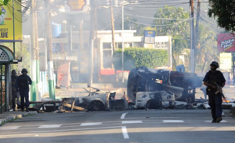 Police patrol on May 24, in Kingston, Jamaica when two police officers were killed after coming under attack amid spreading unrest despite a state of emergency imposed by the government.  (Anthony Foster/Getty Images)