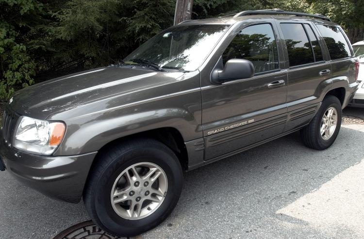 An early 2000 Jeep Cherokee, Kelley's Blue Book Price: $3,500. Obama's 2000 Jeep Cherokee sold for $26,437.50, over $20,000 more then list price.  (Darren McCollester/Getty Images)