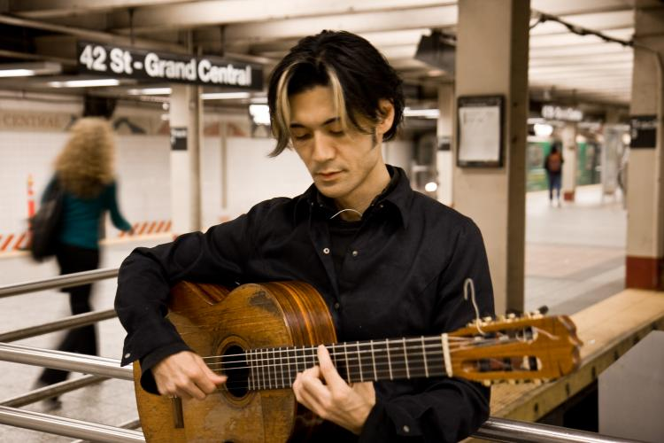 Shogo Kubo plays classical guitar in the subway at Grand Central Station.  (Jasper Fakkert/The Epoch Times)