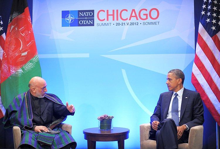Afghan President Hamid Karzai speaks while meeting with U.S. President Barack Obama