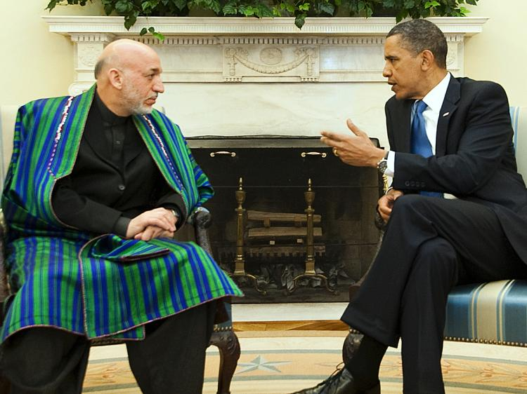 President Barak Obama (R) speaks with Afghanistan President Hamid Karzai during a meeting in the Oval Office at the White House in Washington, DC, May 12, 2010. (Jim Watson/AFP/Getty Images)