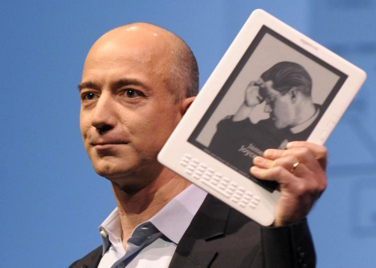 Online retail giant Amazon.com CEO Jeff Bezos with the Kindle DX. (Emmanuel Dunand/AFP/Getty Images)