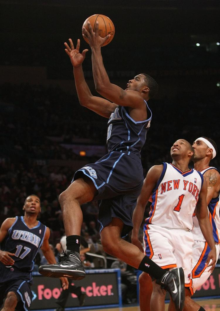 Wes Matthews of the Utah Jazz flys by the Knicks' defense in Monday night's game at Madison Square Garden. The Knicks lost the game 95-93. (Nick Laham/Getty Images )