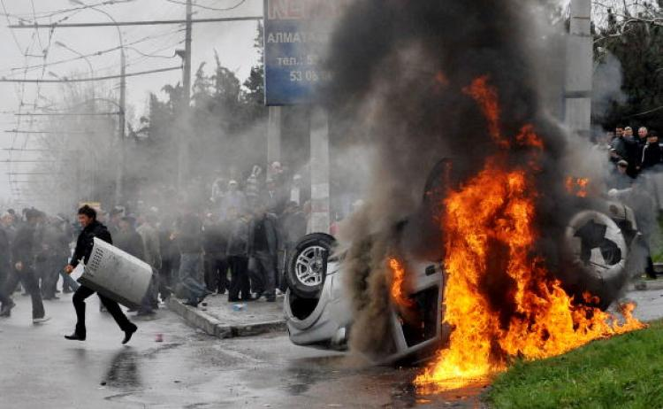 Kyrgyz opposition supporters clash with police during an anti-government protest in Bishkek on April 7, 2010. (Vyacheslav Oseledko/AFP/Getty Images)