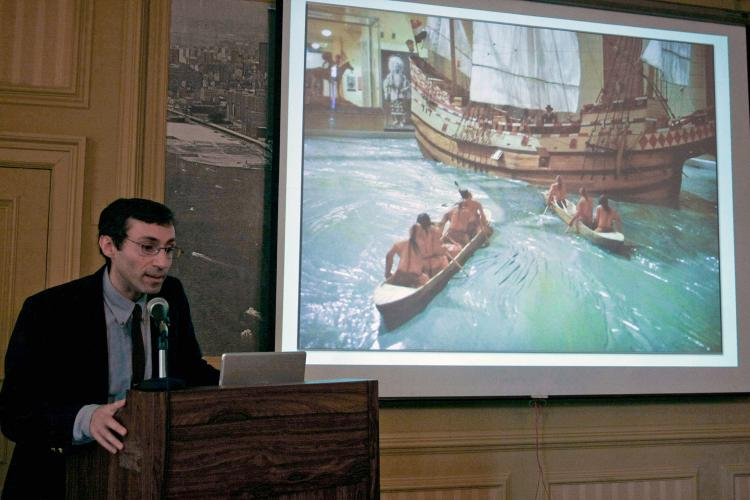 Dr. David M. Oestreicher, an expert on the Lenape, or Delaware, people stands next to a depiction of the Native American canoes greeting the European vessels off the shores of New York City. (Tara MacIsaac/The Epoch Times)