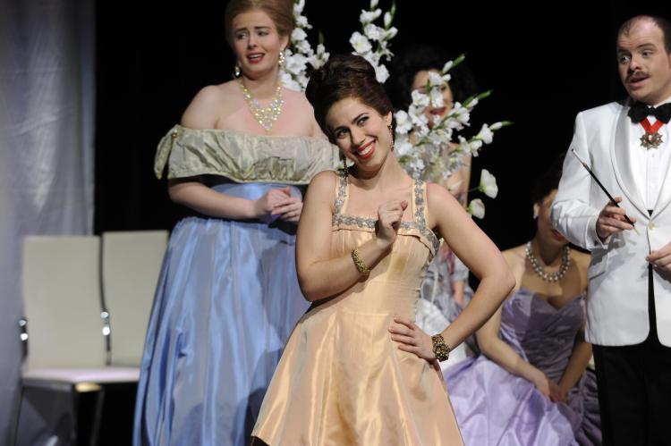 Lucia Cesaroni as Adele in Toronto Operetta Theatre's production of Die Fledermaus, running at the St. Lawrence Centre from Dec. 28 - Jan. 9. Also in the photograph are members of the chorus and Gregory Finney as Orlovsky, the very bored Russian Prince. (Gary Beechey of BDS Studios)