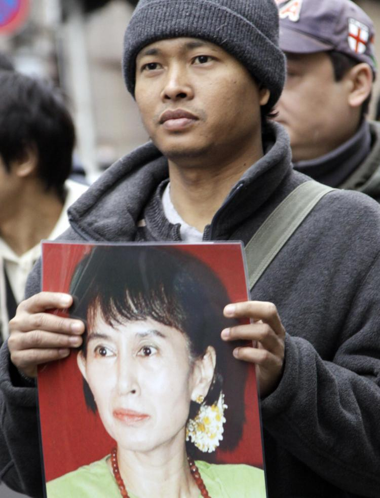 A Burmese citizen living in Japan holds a portrait of detained pro-democracy icon Aung San Suu Kyi during a rally near the Myanmar Embassy in Tokyo on March 13, 2009, the 21st anniversary of Burma's Human Rights Day. (Yoshikazu Tsuno/AFP/Getty Images)