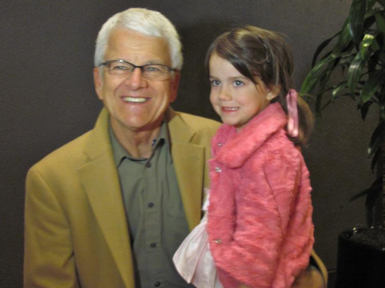 Val Dinkel, a retired owner of a cabinet shop, took his 5-year-old daughter to Shen Yun Performing Arts in Sacramento. (Courtesy of SOH Radio Network)