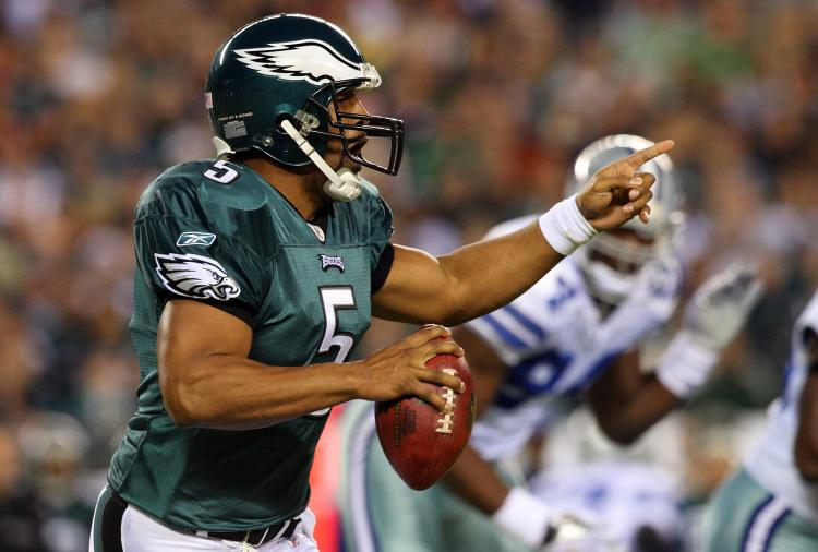 SURVIVOR: Philadelphia QB Donovan McNabb leads his team to an easy victory. (Jim McIsaac/Getty Images)