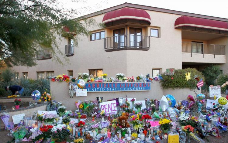 A memorial is set outside of the district office of Rep. Gabrielle Gifford (D-Ariz.) a day after a gunman opened fire on a group of people in Tucson, Ariz. The suspect, 22-year-old Jared Lee Loughner, shot Gifford in the head during a public event titled  (Kevin C. Cox/Getty Images)