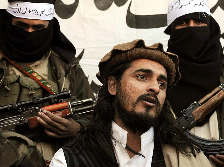 In this photograph taken on November 26, 2008, Pakistani Taliban commander Hakimullah Mehsud speaks to a group of media representatives in the Mamouzai area of Orakzai Agency. (A Majeed/AFP/Getty Images)