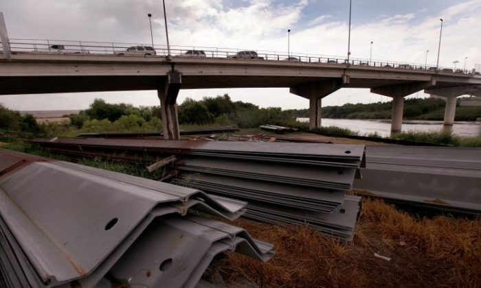 Mexico Border: Sections of steel being used to build the border fence are stacked near a bridge that connects the US with Mexico on May 26. (Scott Olson/Getty Images)